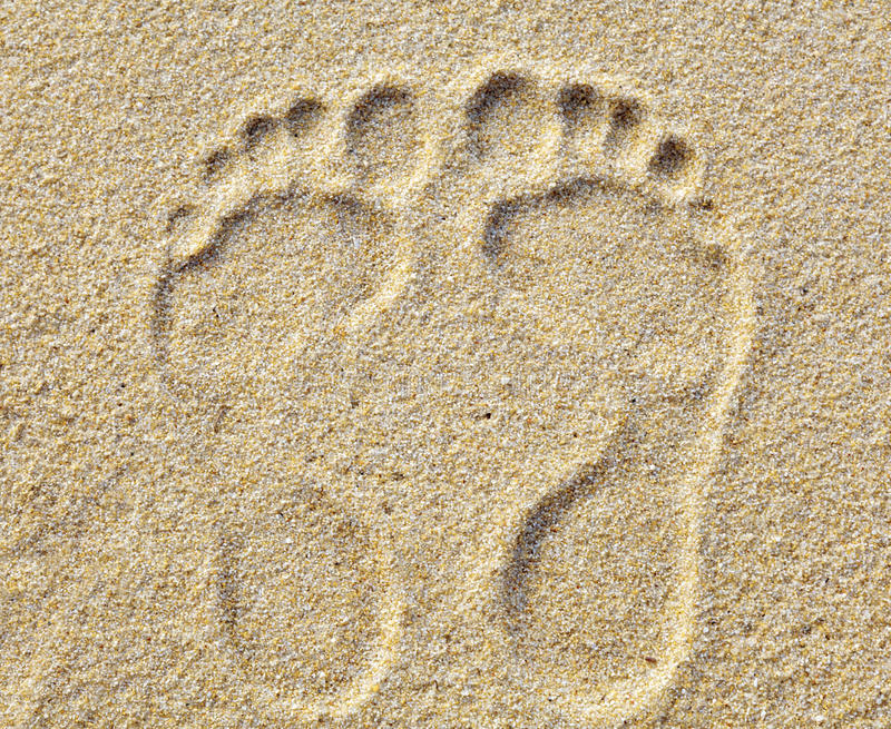Two Footprints in sand at the Beach royalty free stock photography