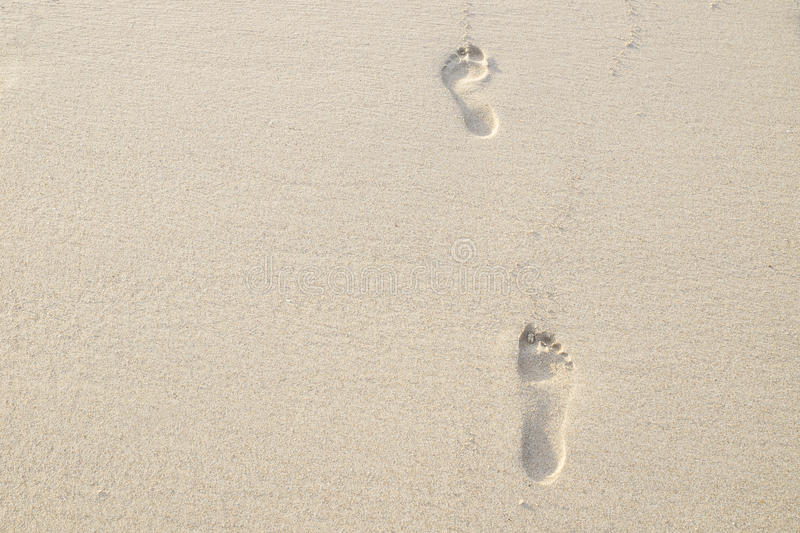 Two footsteps in the sand, Thailand. Two barefoot footsteps in the sand, Thailand stock images