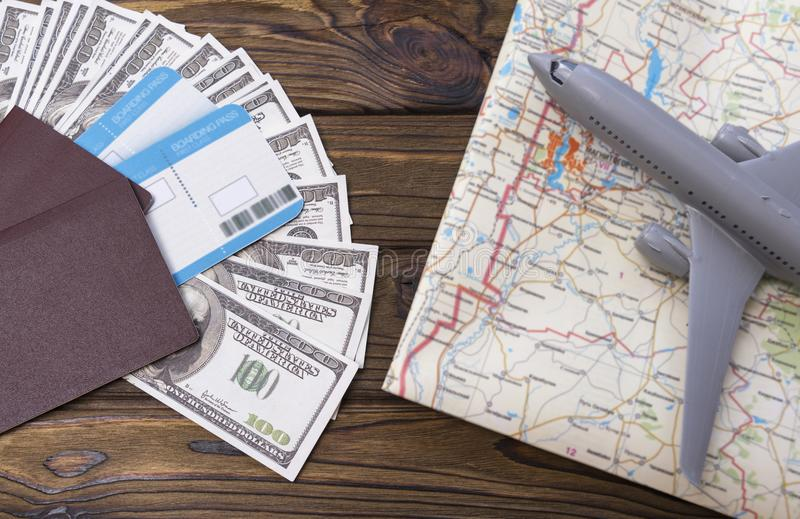 Two foreign passports with enclosed dollar bills with a tourist card and an airplane. Tourism. journey stock photography