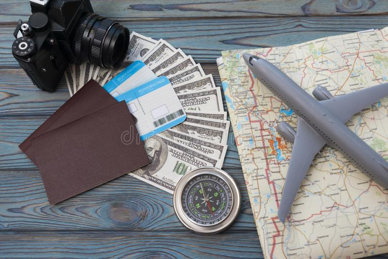 Two foreign passports with enclosed dollar bills. With a tourist card and an airplane. tourism. journey royalty free stock photos
