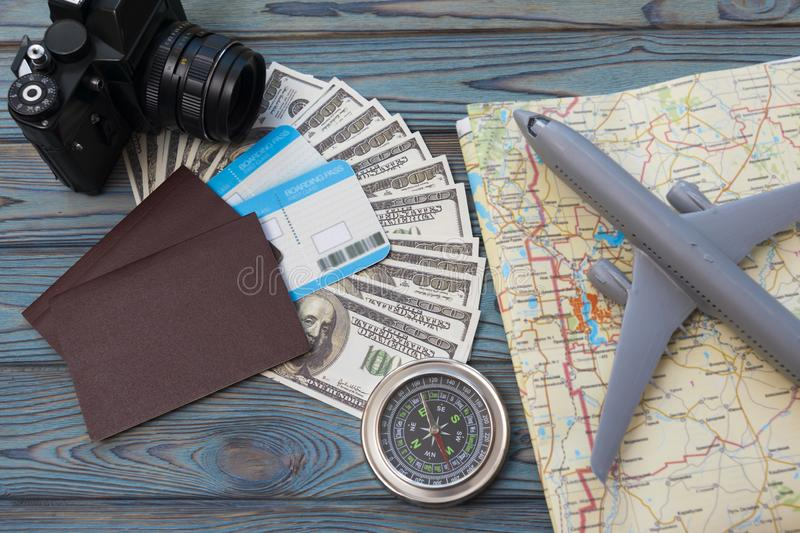 Two foreign passports with enclosed. Dollar bills with a tourist card and an airplane. tourism. journey stock image