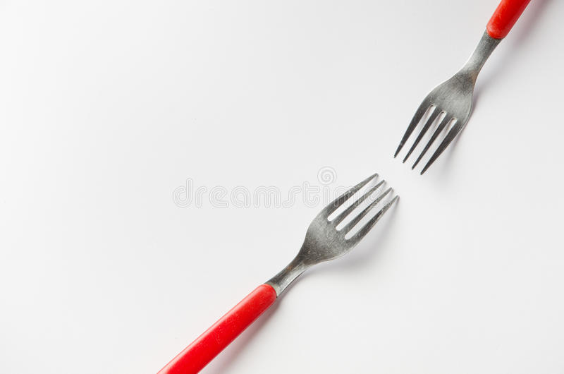 Two forks. Reaching for each other royalty free stock images