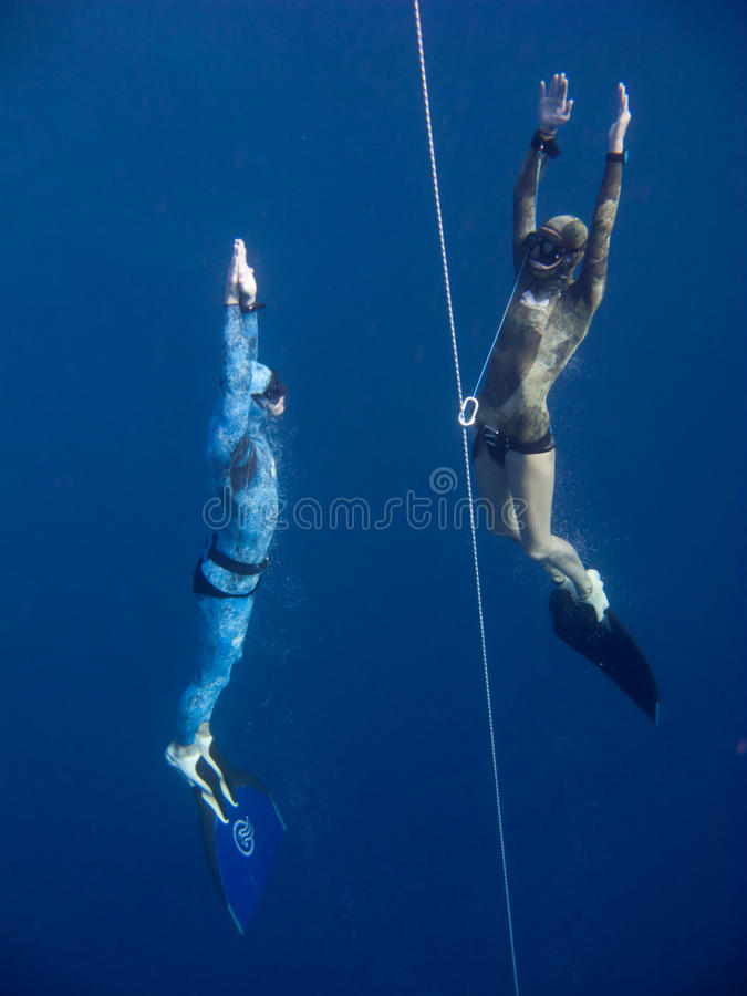 Download Two Freedivers Rise From The Depth Of Blue Hole Royalty Free Stock Photo - Image: 10941835