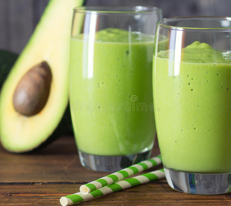Two fresh blended smoothies. Made with avocado royalty free stock image