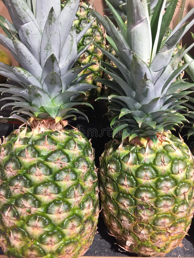 Fresh Pineapples Bromeliaceal at market stock photography