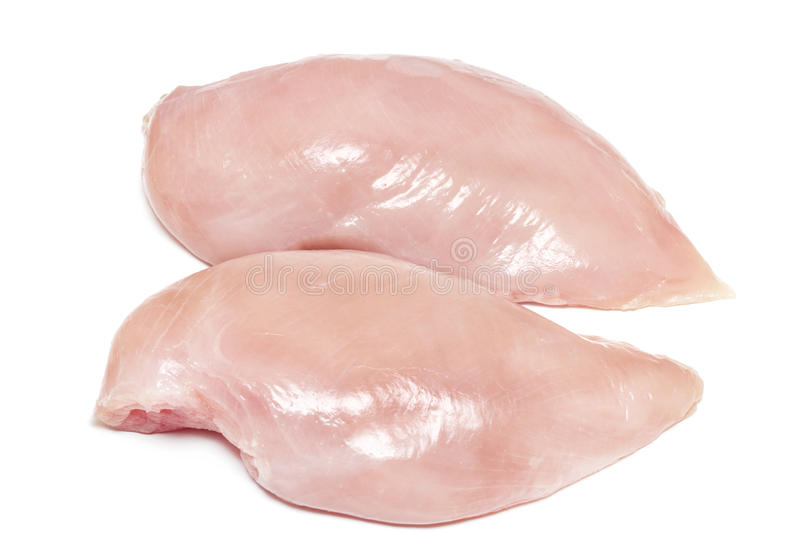 Two fresh raw chicken breasts on white background.  royalty free stock image
