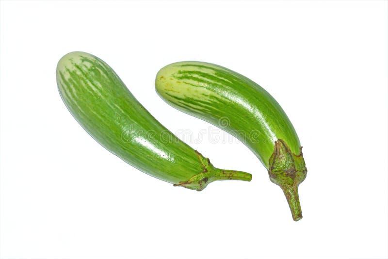 Fresh long green brinjal,thai green eggplant or aubergine on white background. Two fresh,raw and organic long green brinjal,thai green eggplant or aubergine royalty free stock photos