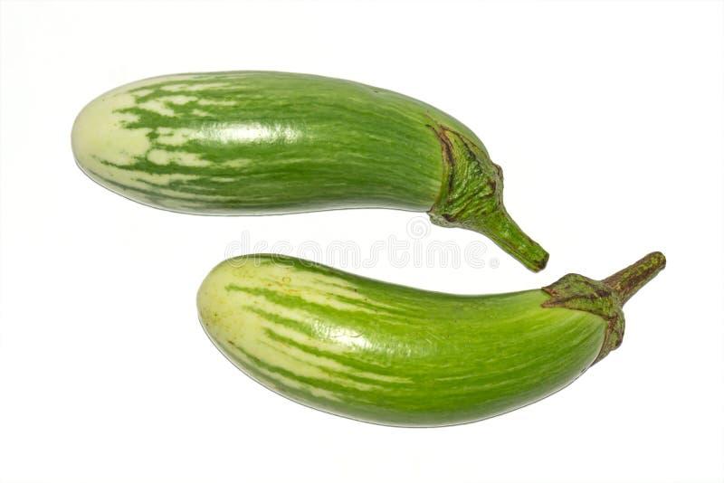 Fresh long green brinjal,thai green eggplant or aubergine on white background. Two fresh,raw and organic long green brinjal,thai green eggplant or aubergine stock photos