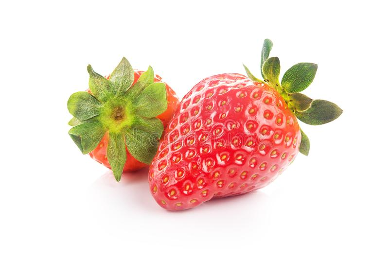 Two fresh red strawberry isolated royalty free stock image