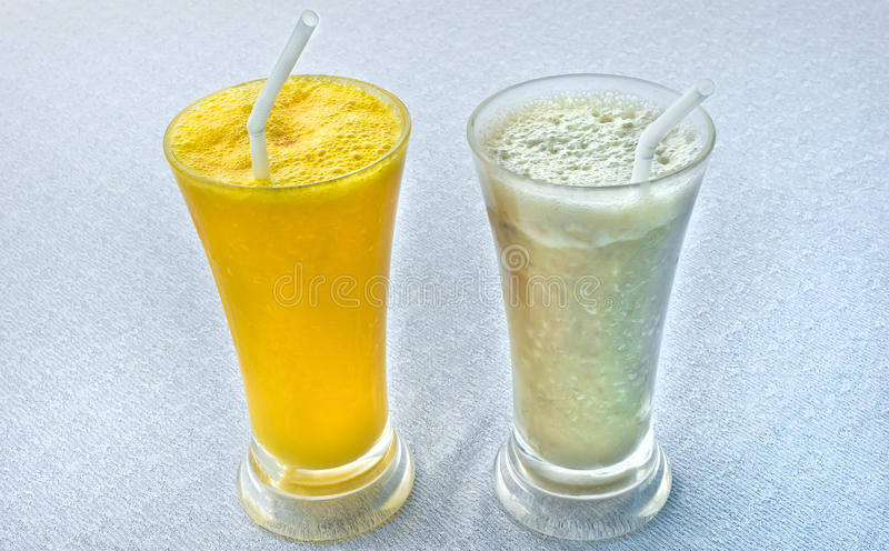 Two fresh tropical milkshakes royalty free stock photo