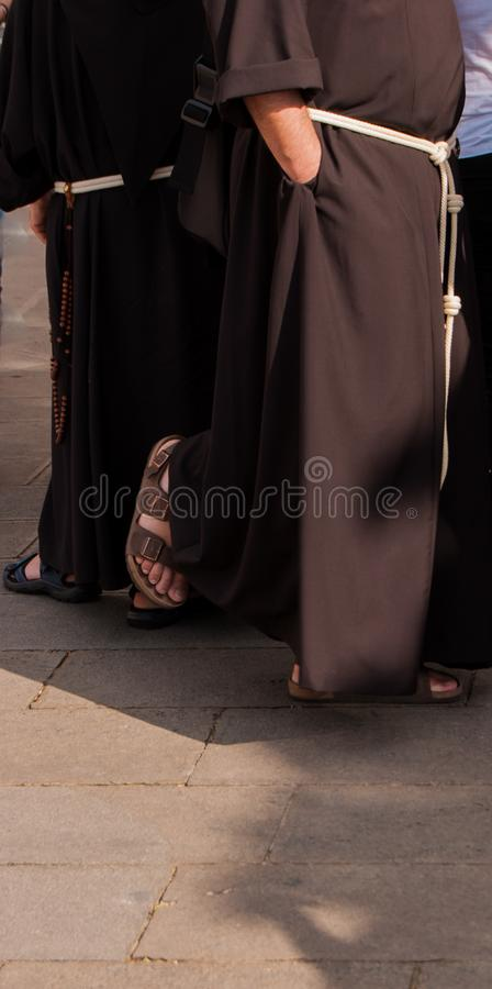Two friars of the Franciscan order. Two friars of Franciscan order with brown habit, white belt and sandals royalty free stock photo