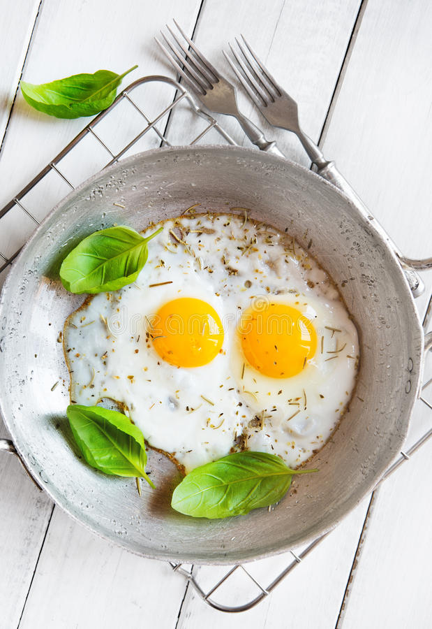 Two fried eggs rustic breakfast royalty free stock images