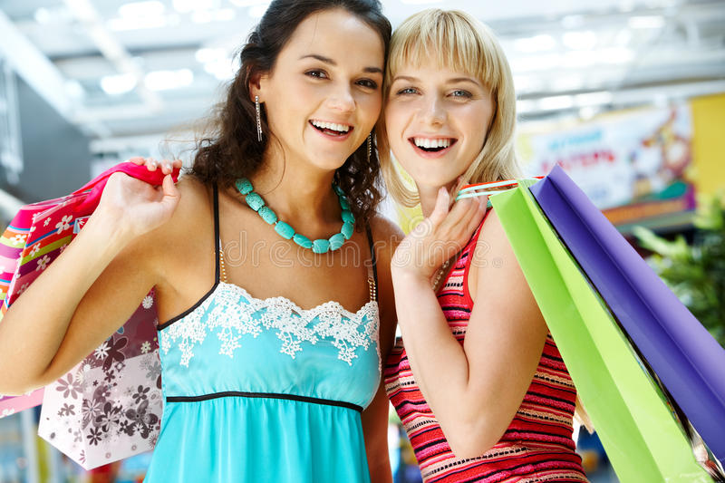 Two friendly shoppers royalty free stock image