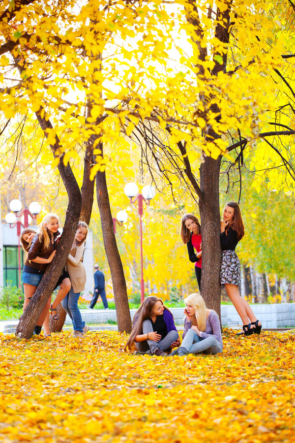 Two friends. Two beautiful teenage girls hugging in the autumn park royalty free stock photos