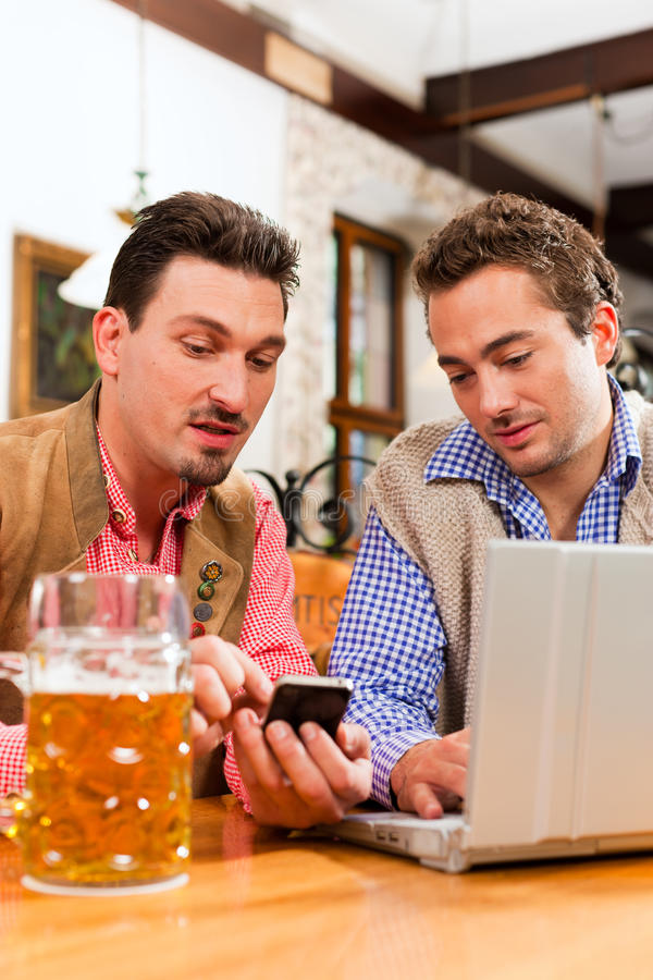 Download Two Friends In Bavarian Pub With Laptop Royalty Free Stock Photo - Image: 21346615