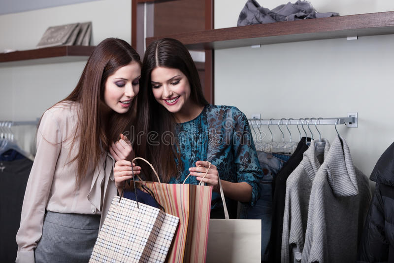 Download Two Friends Buy Presents In A Sale Stock Photo - Image: 26188412