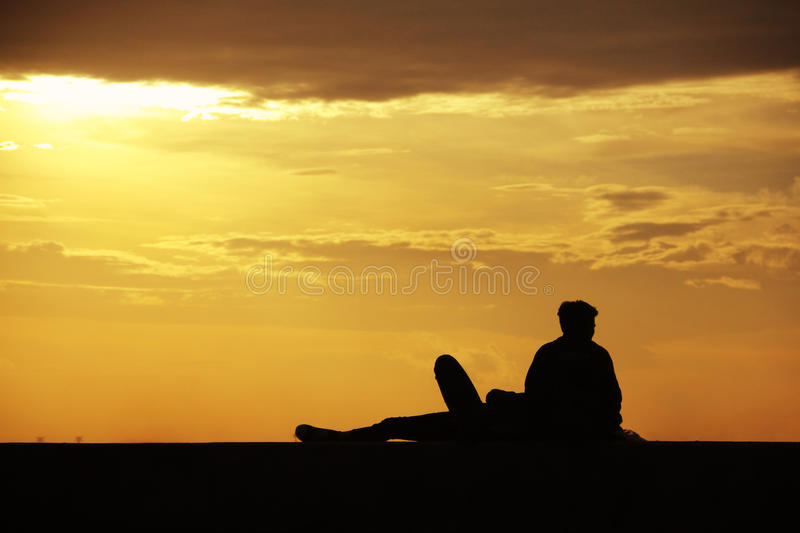 Two friends enjoying sunset view stock images