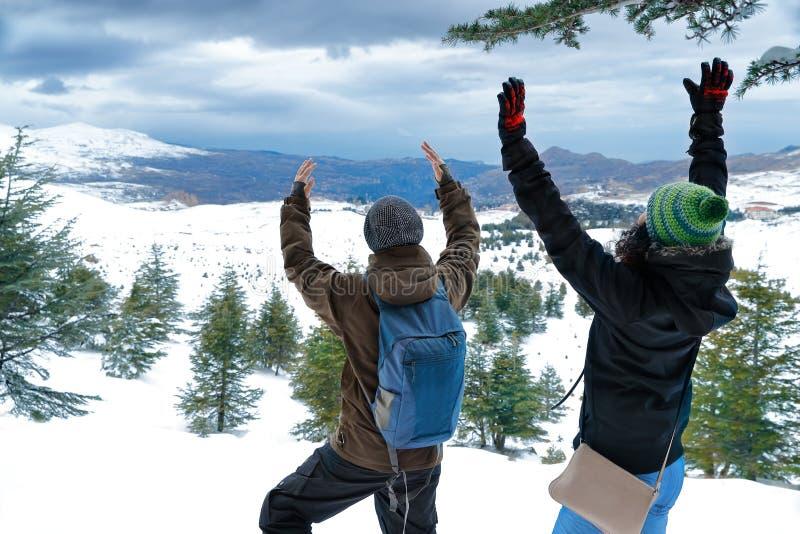 Two friends enjoying winter holidays stock photography