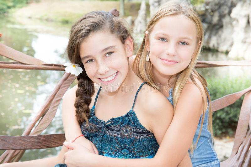 Two friends girls in summer park beauty young teenager royalty free stock photo