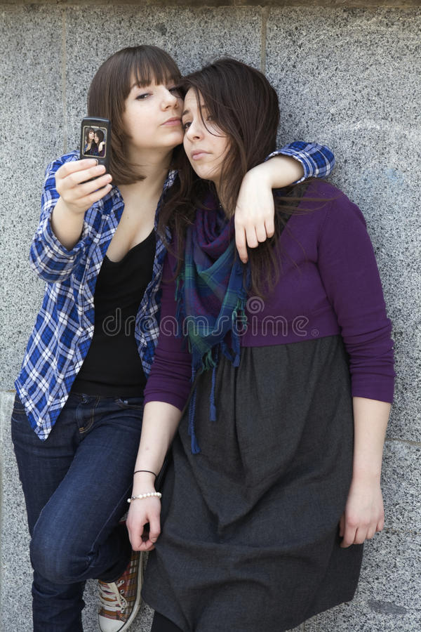Download Two Friends Having A Blast With A Phone. Stock Photo - Image: 11044584