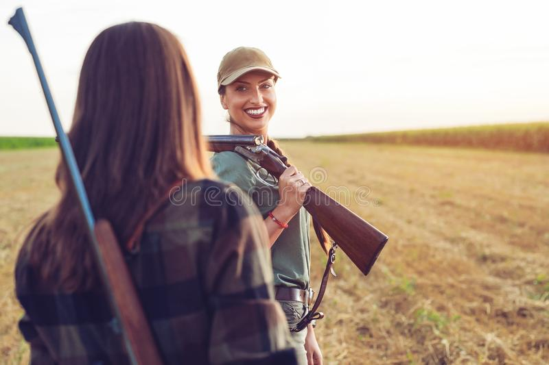 Two friends hunting watching wild. royalty free stock images