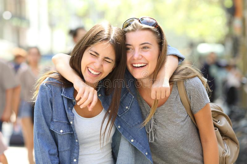 Two friends laughing loud in the street stock photo