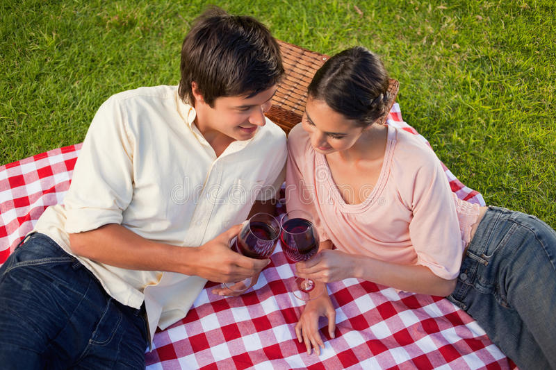 Two Friends Looking Downwards While Holding Glasses Of Wine Stock Photos