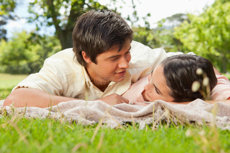 Download Two Friends Looking Into Each Others Eyes While Lying On A Blank Stock Image - Image: 25332609