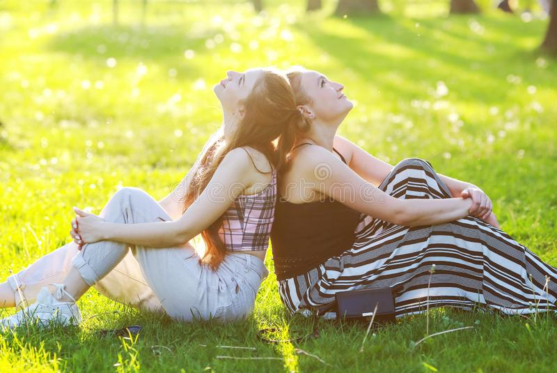 Two friends in the park stock photos