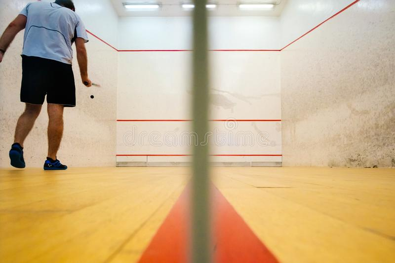 Two friends playing squash in Mutilva, Navarra, Spain royalty free stock photos