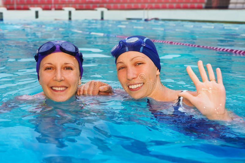 Download Two friends in the pool stock photo. Image of active - 27299066
