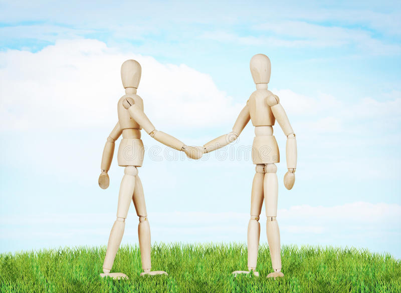 Two friends shake hands to each other stock images