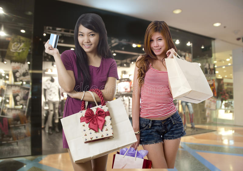 Download Two Friends Shopping At The Mall Stock Image - Image of indoors, card: 19713509