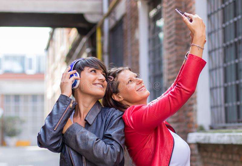 friends are taking a selfie in a urban street royalty free stock image