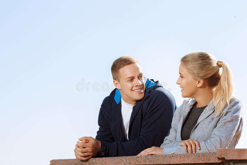 Two friends talking during a break. Outdoors royalty free stock image