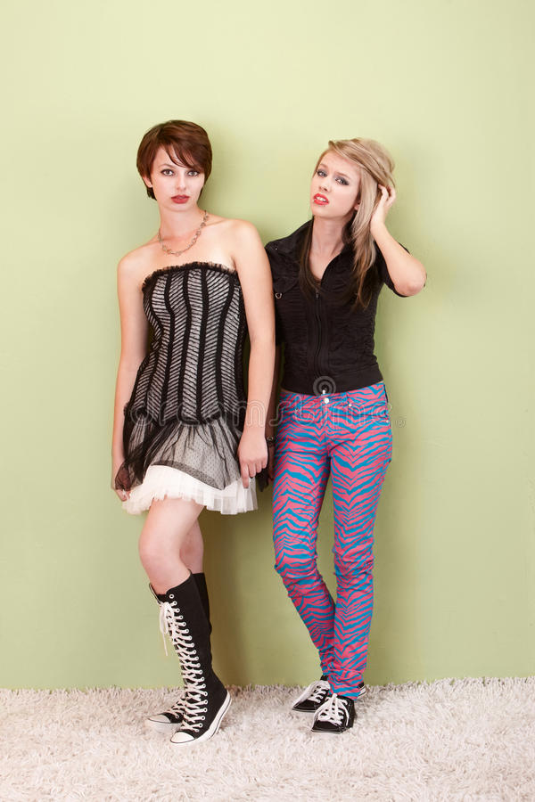 Two frustrated punk teen girls look to the camera stock image