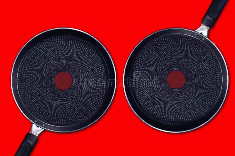 Two frying  pans with non-stick coating stock image
