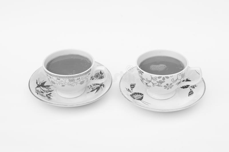 Two cup of coffee on a tray with white background. mono royalty free stock photography