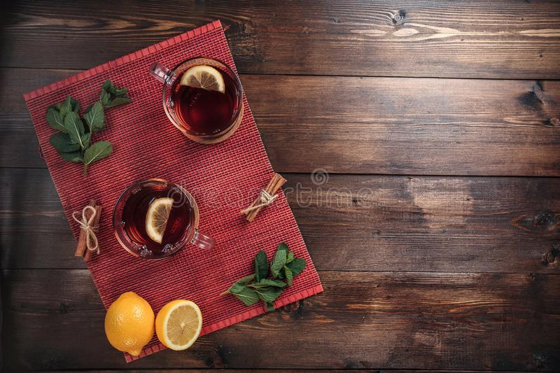 Two full cups of black tea with lemon stock images
