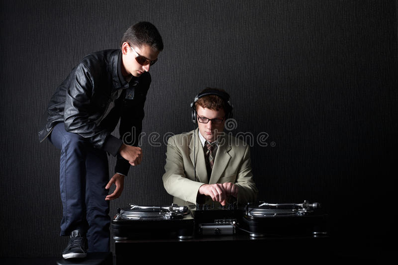 Two funny boys with dj booth. Photo of two funny boys with dj booth stock photography