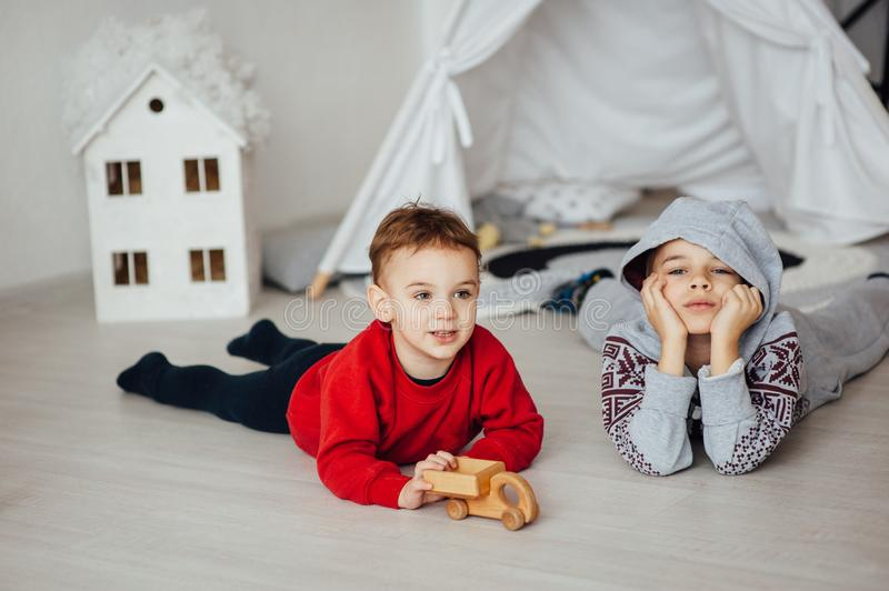 Two funny boys play together. Cute happy brothers smiling and having fun.  royalty free stock photography