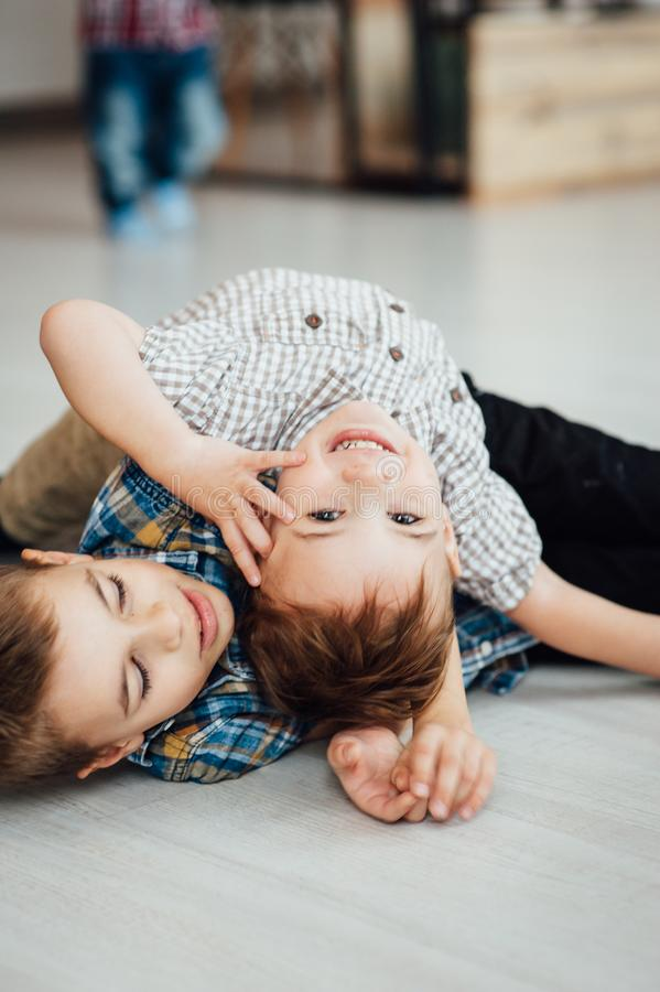 Two funny boys play together. Cute happy brothers smiling and having fun.  royalty free stock photos