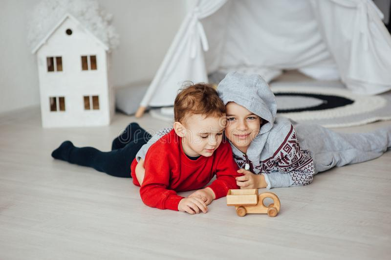 Two funny boys play together. Cute happy brothers smiling and having fun.  stock images