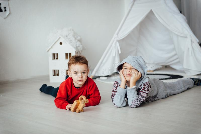 Two funny boys play together. Cute happy brothers smiling and having fun.  stock photography