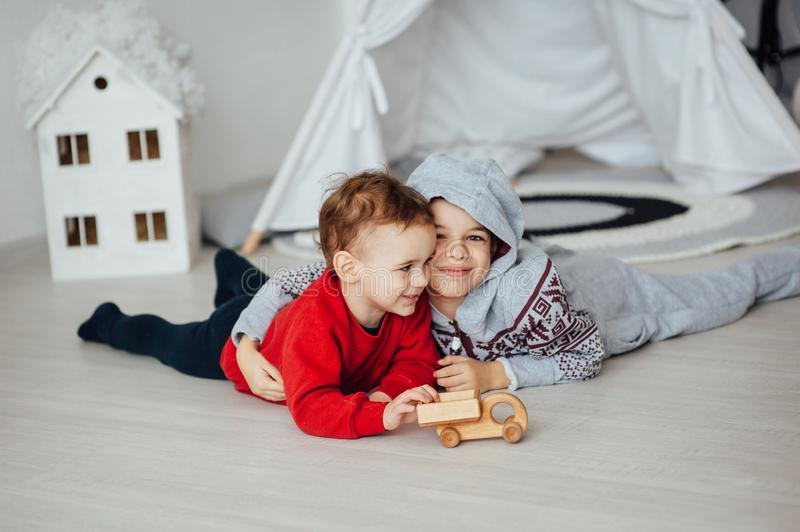 Two funny boys play together. Cute happy brothers smiling and having fun.  stock image