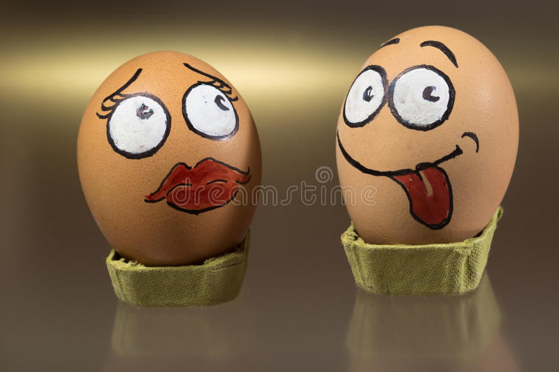 Two funny egg faces. Male defy and female in love royalty free stock photography