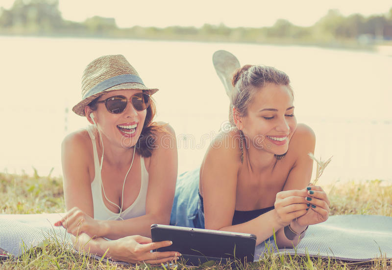 Two funny happy young women friends enjoying summer day outdoors stock photography