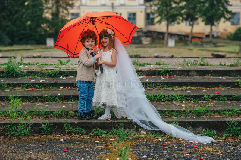 Two funny little bride and groom royalty free stock images