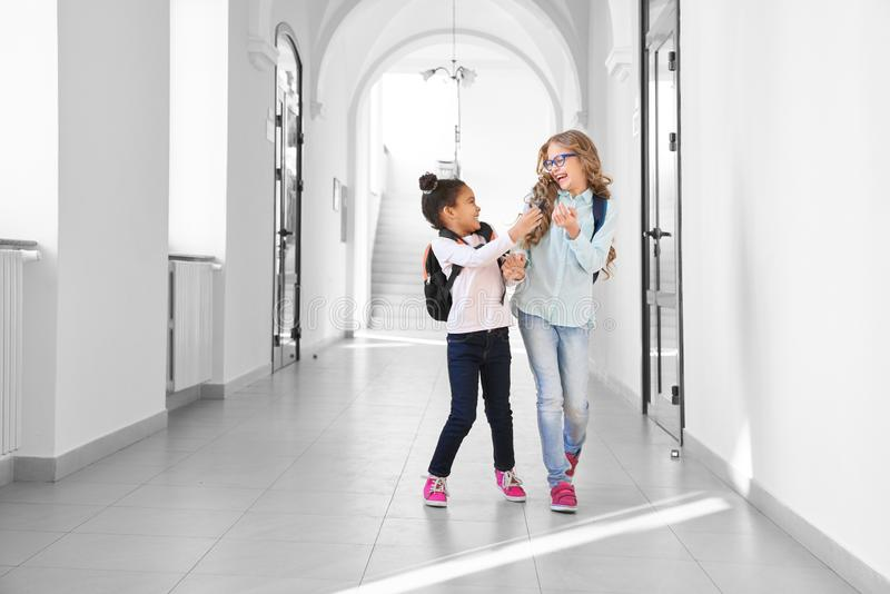 Two funny school girls playing and having fun. royalty free stock image