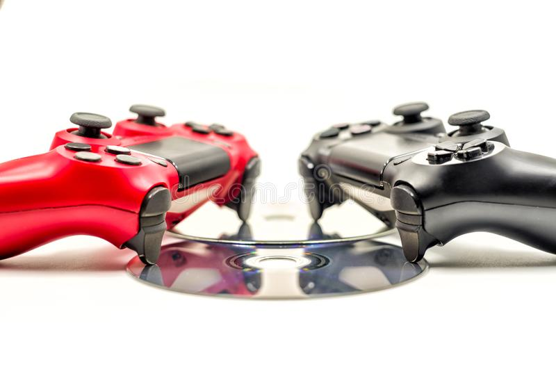 Two game controllers on cds isolated on white royalty free stock images